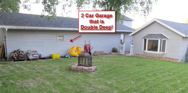Home with 4 car garage now 99 000 rock realty for Homes with 4 car garages